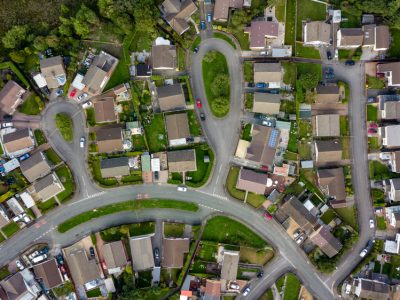 Top,Down,Aerial,View,Of,Urban,Houses,And,Streets,In